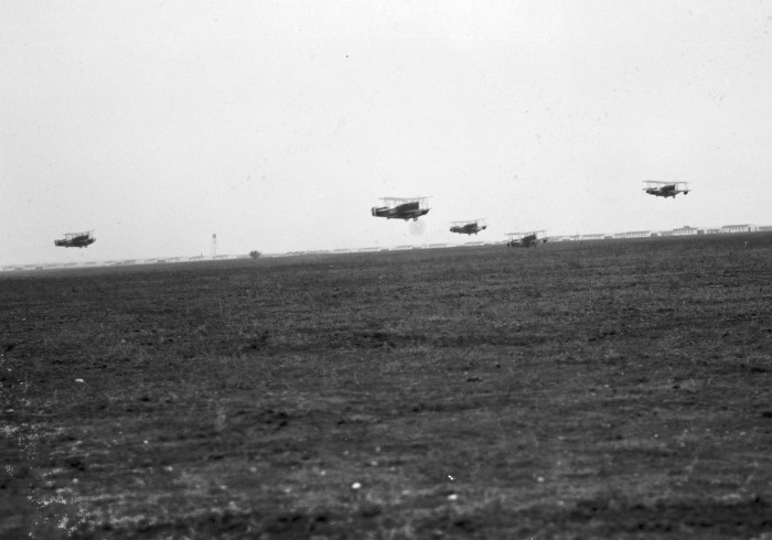 The Loening amphibians fly in a five-ship formation for the first time, December 17, 1926. Kelly Field in distance. (MS 359: L-0739-O)