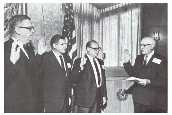 New regents sworn in by Chief Justice Robert Calvert at the Alumni Center are, left to right, Frank Ikard, Joe Kilgore, and Dr. Edward Ximenes. Courtesy Alcalde, The University of Texas Alumni Magazine, September 1967.
