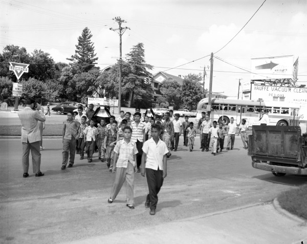 "Residents of St. Peter's-St. Joseph's Home walk toward Josephine Theater for special screening of Walt Disney's new movie, ""Darby O'Gill and the Little People,"" July 15, 1959. (MS 355: Z-0750-N-01)"