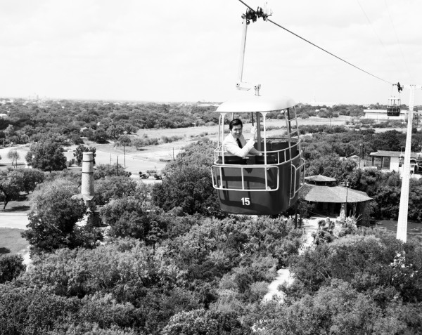 "Actor Fess Parker on the Brackenridge Park skyride during his visit to city to participate in the ""Tops in Talent Extravaganza,"" August 1965. (MS 355: Z-0751-H-52390)"