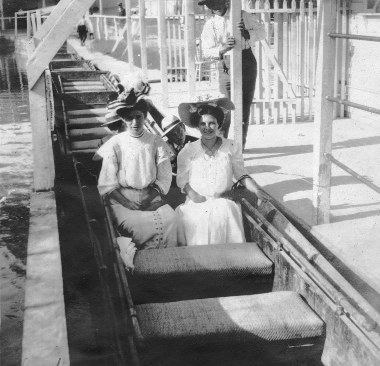 Olive Nesbitt (right) and a friend on a ride in Electric Park, West Evergreen Street at San Pedro Creek, San Antonio, circa 1910. (MS458: 115-0360)