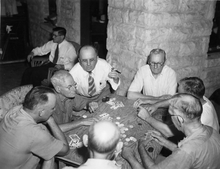 Friends of Charles H. Brewster, Sr., play poker at a camp in the Texas Hill Country, circa 1940. (MS458: 115-420)