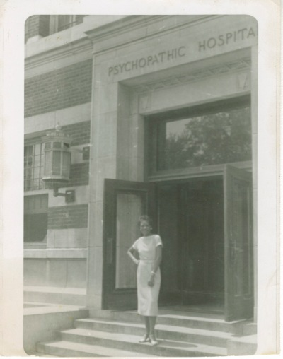Ms. Austin stands in front of the hospital in Chicago where she worked.