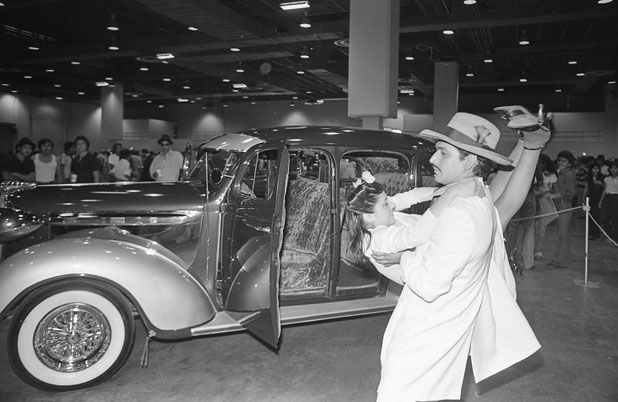 Brother-sister dance team Isaac Cardenas and Lisa Cardenas during zoot suit contest at low riders convention, August 30, 1980. (San Antonio Express-News Collection, MS 360: E-0064-036-33)