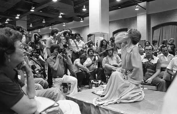 Photographers and model at photography trade show, September 13, 1980. (San Antonio Express-News Collection, MS 360: E-0064-076-44)