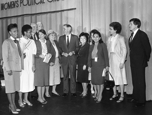 Former Vice President Walter Mondale (center) stands between Bella Abzug (left) and Patsy Mink at National Women's Political Caucus, July 10, 1983. (San Antonio Express-News Collection, MS 360: E-0168-044-37)