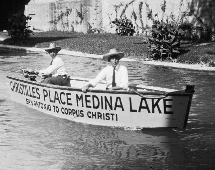 "Fred Christilles (left), skipper, and his son-in-law Jimmy Hanway, first mate, pose in the ""Play Boy"" shortly after it was launched into the San Antonio River a few days before the race. (MS 359: L-0804-A)"