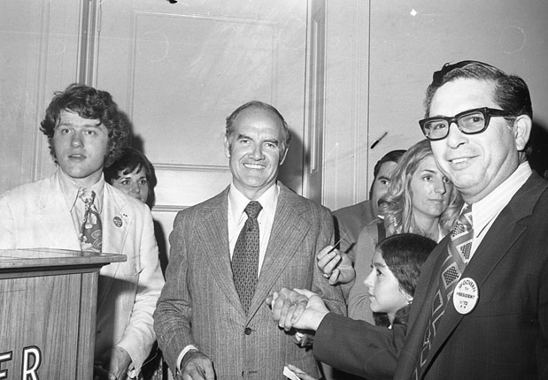 Following an evening rally on Alamo Plaza, Senator George McGovern poses with supporters at a reception in the Menger Hotel, October 16, 1972. On the left is Bill Clinton, a coordinator of the McGovern-Shriver campaign in Texas. (MS 360: E-0026-004-07)