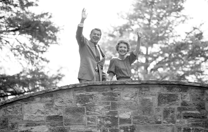 Ronald and Nancy Reagan pause on a pedestrian bridge over the San Antonio River Walk before proceeding to a rally at the Henry B. Gonzalez Convention Center, September 16, 1980. (MS 360: E-0064-081-33)