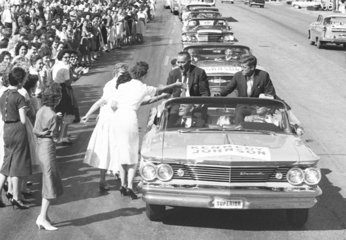 The Kennedy-Johnson motorcade stops briefly for supporters outside USAA on Broadway as it heads from the airport to downtown, September 12, 1960. At Alamo Plaza, Kennedy issued a challenge for better relations between the United States and its Latin American neighbors. (San Antonio Light Collection, MS 359: L-6186-D-09)