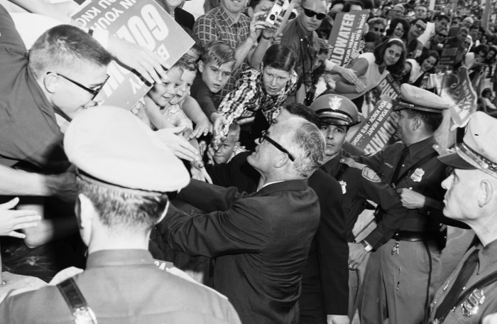 Republican Senator Barry Goldwater shakes hands with enthusiastic supporters following a speech to a crowd of 15,000 in Alamo Stadium, October 31, 1964. (San Antonio Light Collection, MS 359: L-6235-E)