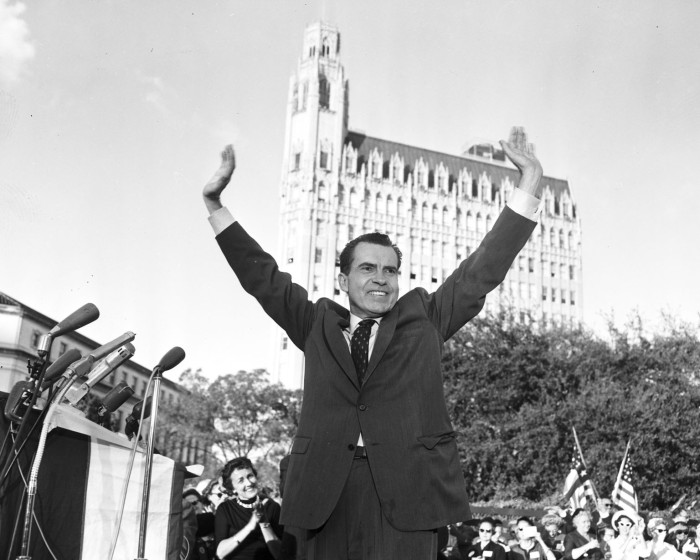 Vice President Richard M. Nixon, Republican presidential nominee, responds to the cheers of the 20,000 people gathered on Alamo Plaza during his final campaign trip across Texas, November 3, 1960. Nixon selected the Alamo as the site for what he called the most important speech of his campaign. (San Antonio Light Collection, MS 359: L-6355-H)