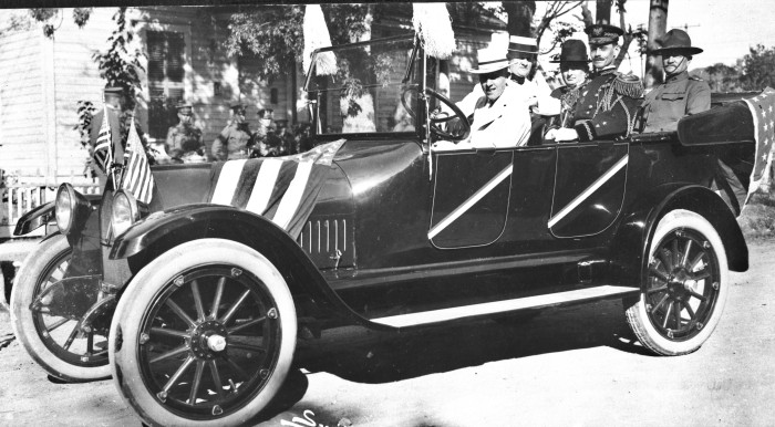 San Antonio's annual Battle of Flowers Parade on April 20th, with car occupied by (left to right, behind driver) Atlee B. Ayres, president of the Fiesta Association; Texas Governor James E. Ferguson; Adjutant General Henry Hutchins; and Major General John J. Pershing, commander of Fort Sam Houston. (083-0606. Courtesy of Ann Russell)