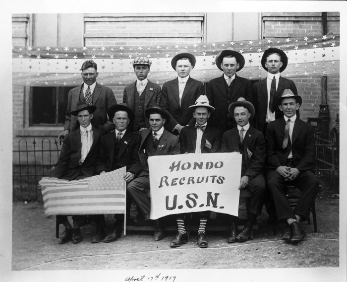Hondo residents pose in front of patriotic bunting before leaving for service in the United States Navy during World War I. (096-0481. Courtesy of Frances Miller)