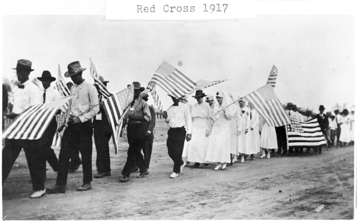 Parade organized to encourage donations and recruit volunteers for the Red Cross war-time services, Paint Rock. (097-0098. Courtesy of Concho County Courthouse)