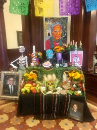 Ofrenda for the departed. Antonio Gonzalez, recently deceased director of the Southwest Voter Registration Education Project, is pictured on the left.