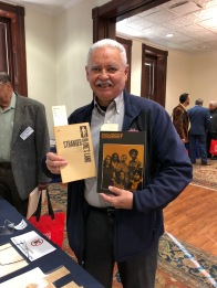 Armando Rendon, Deputy Information Officer for the US Commission on Civil Rights from 1967-1969, holding publications from 1968 that he contributed to.