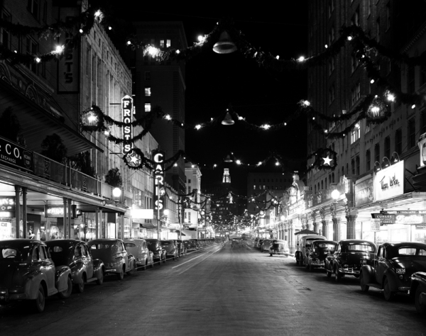 Christmas decorations on Houston Street. View looking East between St. Mary's and Navarro Streets. December 1947.