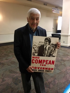 Mario Compean holding a campagin poster from the Fred Graza Collection