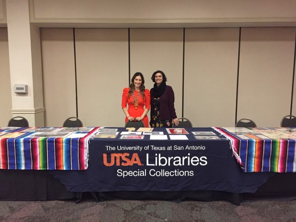 UTSA exhibit table with Leah Rios & Katie Rojas