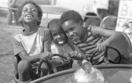 Children at carnival during Juneteenth celebration, June 13, 1983, SA Express News Photography Collection, MS 360