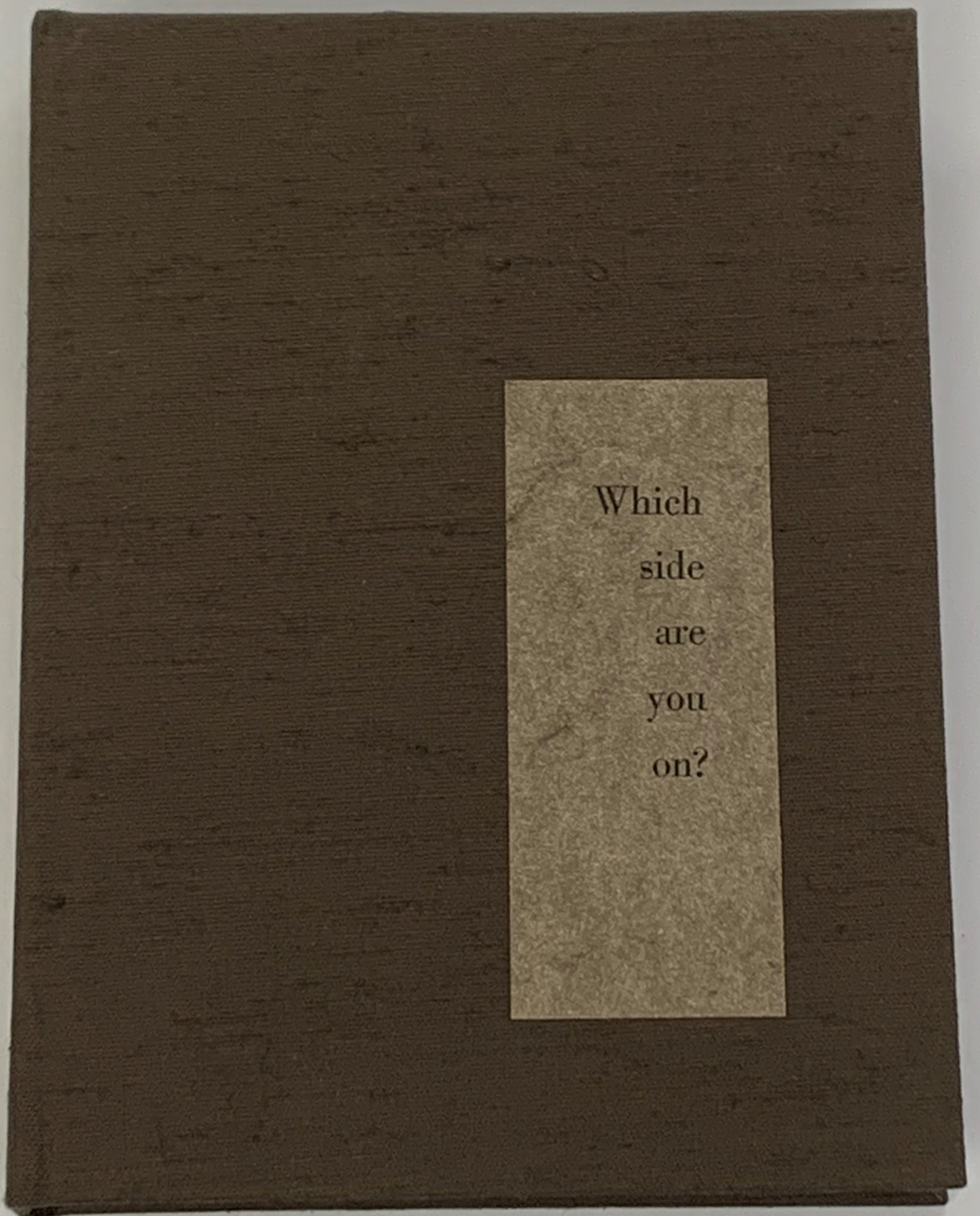 """brown fabric covered clamshell storage box with a tan label in the lower right hand corner with """"Which side are you on?"""" printed on the label"""